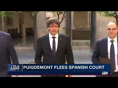 Catalonia's Carles Puigdemont flees Spanish court, denouncing the trial as political