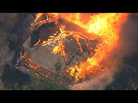 Bushfires rage after Australia's hottest summer on record
