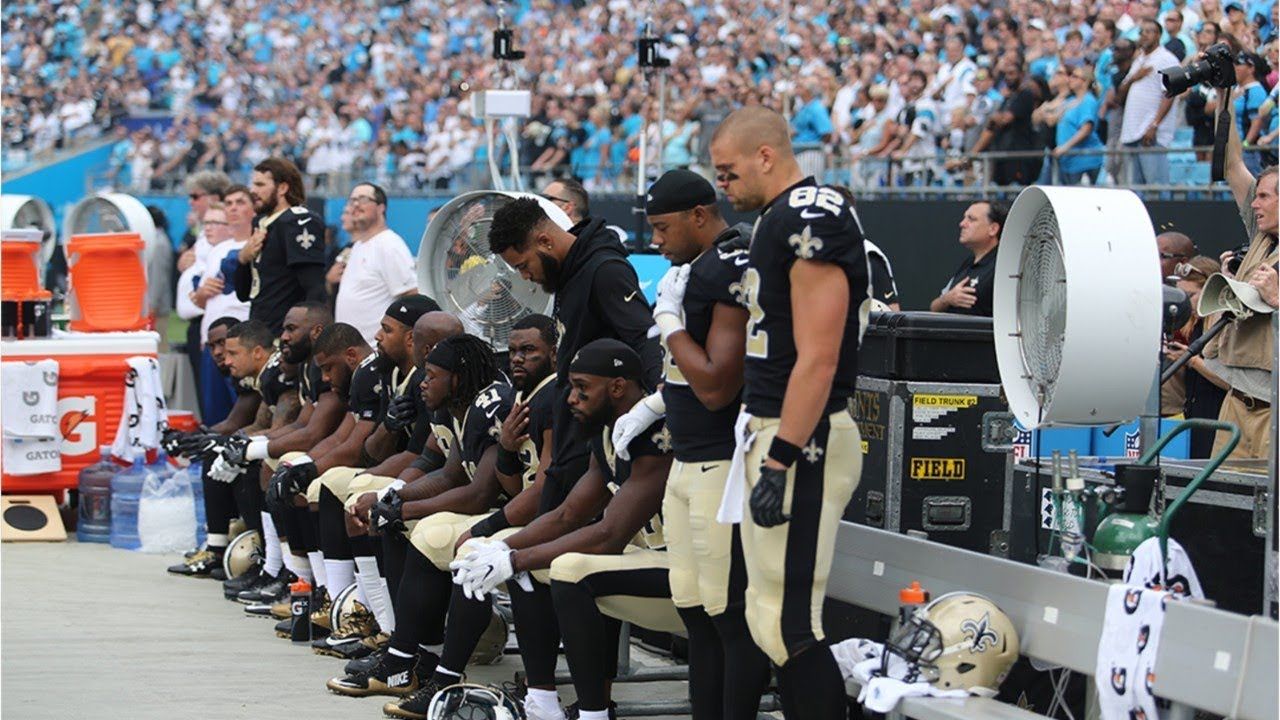 NFL players kneel during National Anthem in protest of Trump's comments