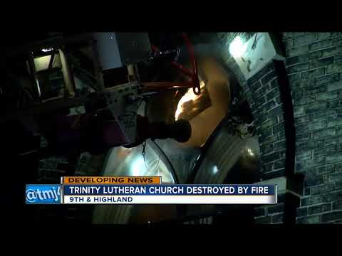 Overnight fire flares up again at Trinity Evangelical Lutheran Church