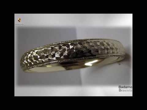женские жесткие золотые браслеты из белого и желтого золота
