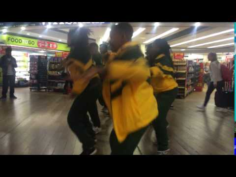Team South Africa dance at Heathrow Terminal 3