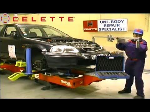 Honda Civic body repair on a Celette car frame machine, setup with universal jig, measuring system.