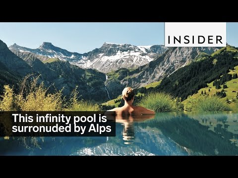 This Infinity Pool Is Surrounded By Views Of The Swiss Alps
