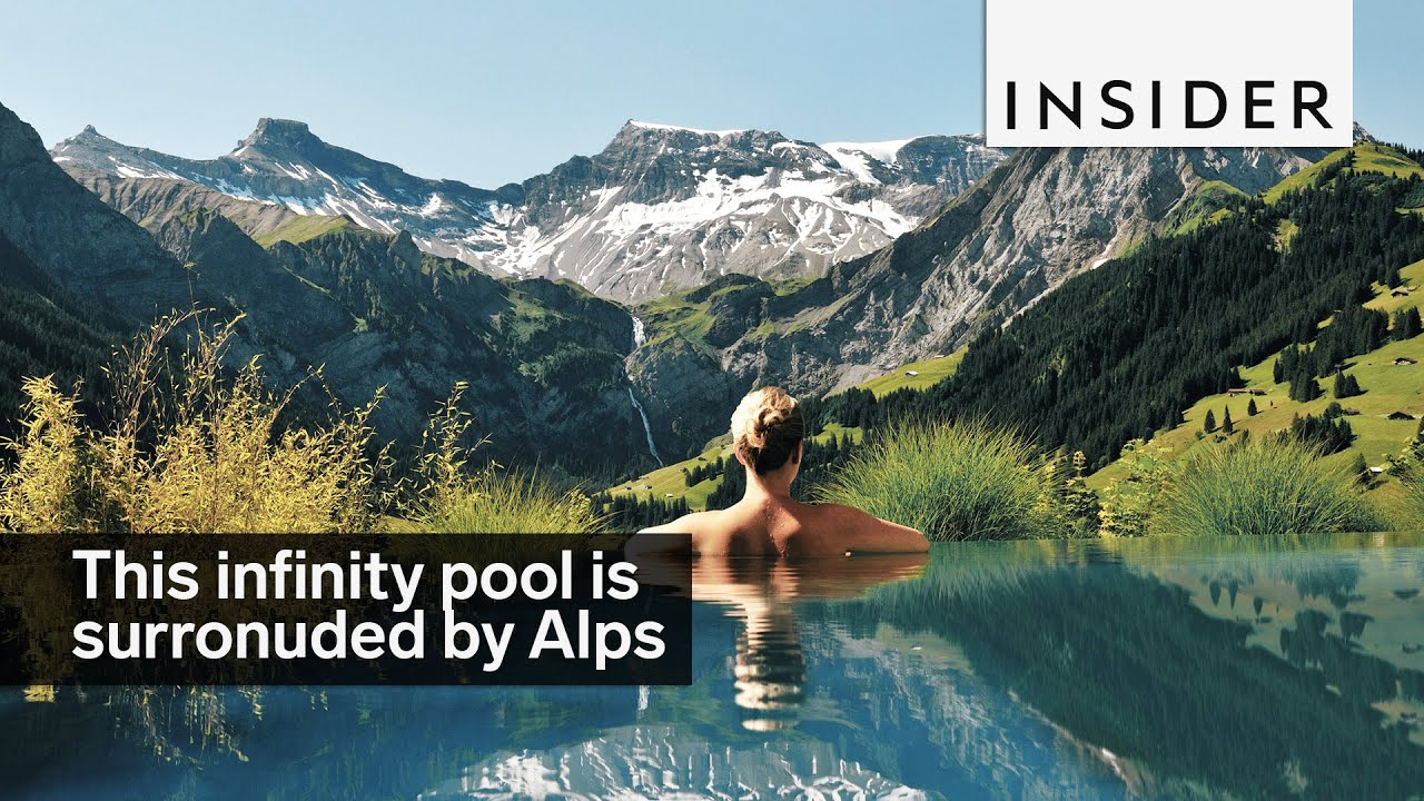 this infinity pool is surroundedviews of the swiss alps - youtube