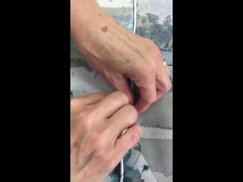 Inserting Lead Weight Bead Chain Into A Curtain Hem