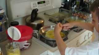 Daniel makes breakfast.