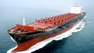 Big Container Ship Sailing On Sea