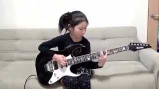Amazing cool 8 year girl playing guitar
