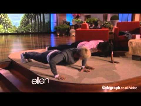First Lady Michelle Obama does press ups...