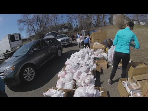 Thousands Of Cars Lined Up To Receive Food Donations From Local Church