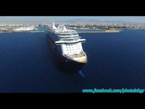 Aerial (drone) video - Mein Schiff 3 leaving Piraeus port