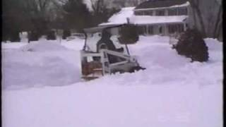 MINI BOBCAT SKID STEER PLOWING SNOW