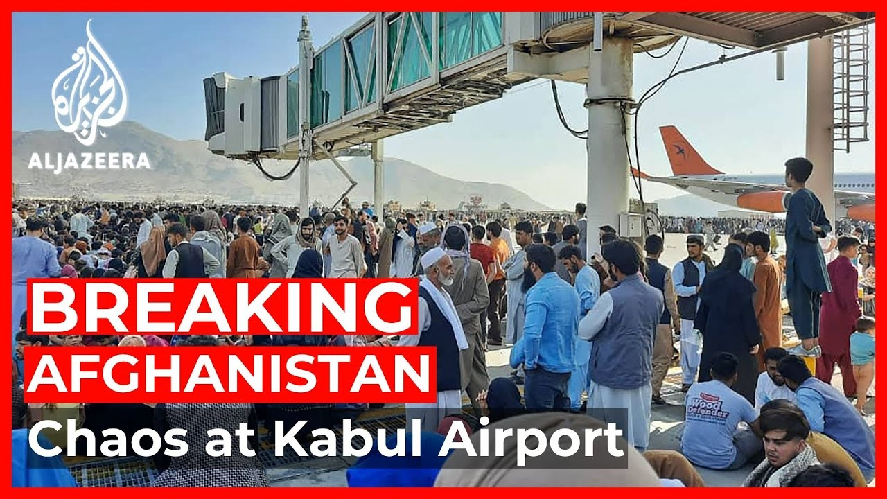 Desperation at Kabul airport as Afghans try to flee - YouTube