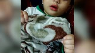 Baby playing peekaboo