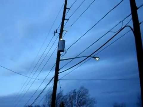 Fire And Sparks On An Electrical Utility Pole During High Winds