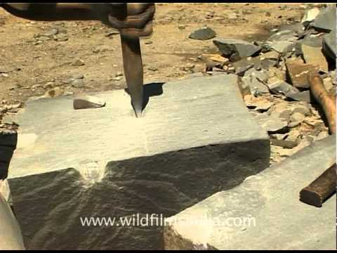 Manual labour - Breaking and chiseling large rocks in Nagaland