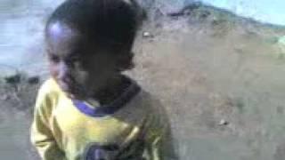 Young boy singing Morena o tseba mathata a rona by Sechaba.