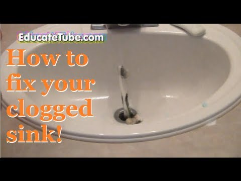 bathroom sink clogged. How to fix your clogged bathroom sink with a coat hanger  Repair fast and easy way YouTube