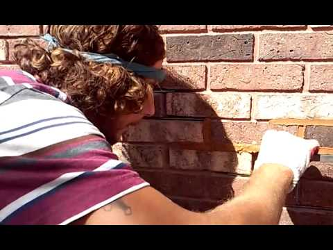 Brick pointing fixing stair step crack