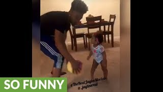 "Baby gets ""embarrassed"" in 1-on-1 basketball with dad"
