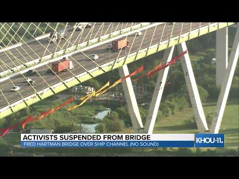 Dana McKenzie - Watch Live: Activists suspended from Fred Hartman Bridge in Houston