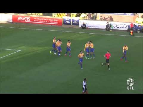 Neal Bishop scores at Grimsby