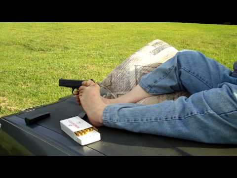 Michael shoots his .45 with his feet