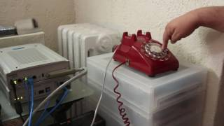Dialing the emergency services number on a rotary phone