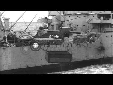 Ammunition being unloaded from United States ship Mount Katmai onto air craft car...HD Stock Footage
