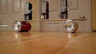 Synchronization of Three Metronomes