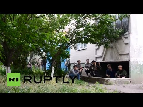Ukraine GRAPHIC: Video of militia fighter shot in head amid Lugansk fierce gunbattle