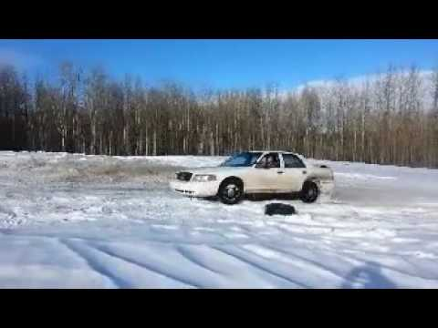 Crown Victoria Donuts Through Deep Snow On Bald Summer Tires