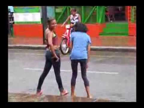 Sosua Hotel Girls Playing in Rain in Front of Dominican Republic Restaurant
