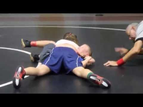 Youth wrestling, girl pins boy