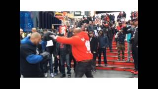 Shannon Briggs doing Pad work at Times Square with Coach Nelson from Supreme Team Boxing