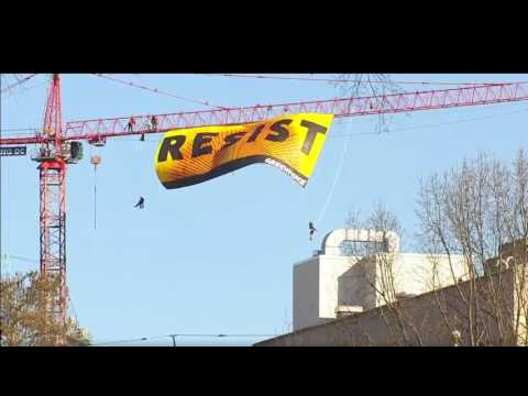 Protesters are climbing a crane near The White House