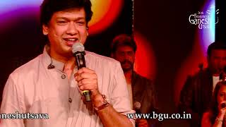 "Vijay prakash singing ""belageddu yaara mukava"" from the movie ""kirik party"" at 56th bengaluru ganesh utsava, 2018"