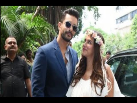Pregnant Neha Dhupia Glows As She Poses With Hubby Angad Bedi At Her