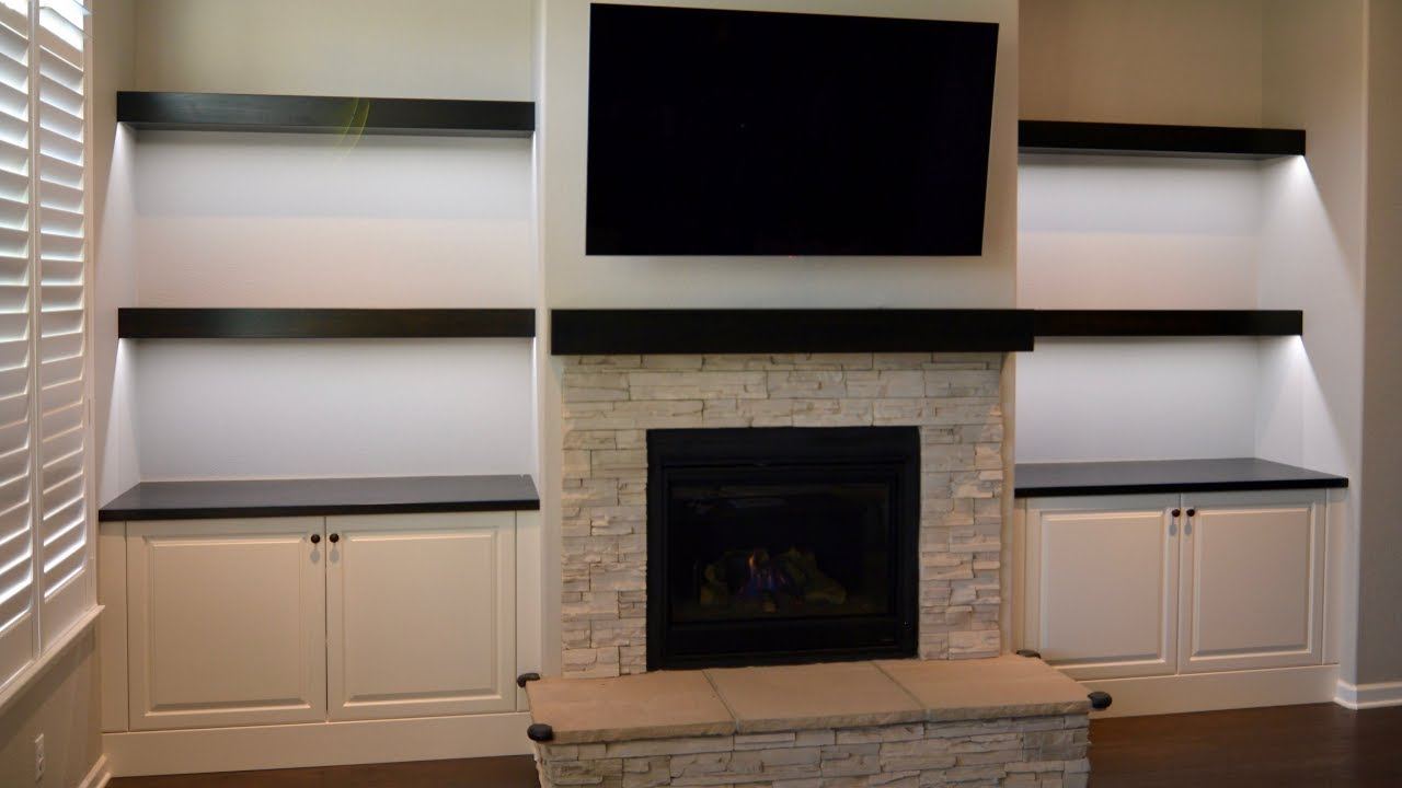 Custom Built In Cabinets Floating Shelves And Fireplace