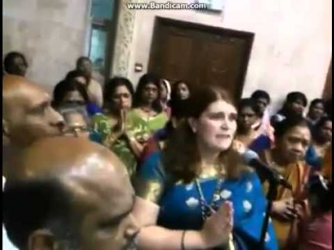 White lady devotee sings a traditional Tamil Thevaram (Ancient devotional songs )