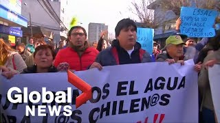 Chileans take to the streets to protest fuel spill that left city without drinking water
