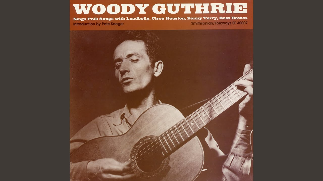 we shall be free lyrics woody guthrie