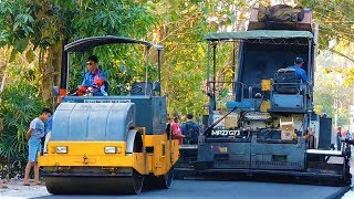 Gambar cover Hot Mix Asphalt Construction Work By Paver Finisher Tandem Tire Roller and Dump Trucks