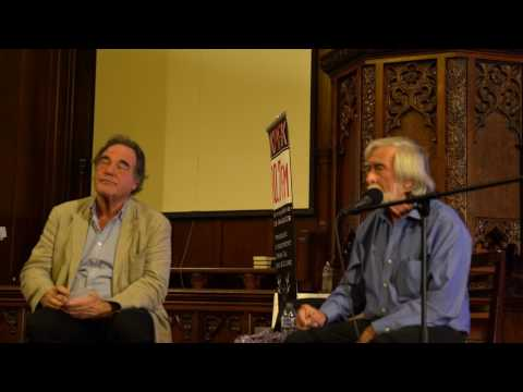 Robert Scheer with Oliver Stone on how the government dictates journalistic narrative