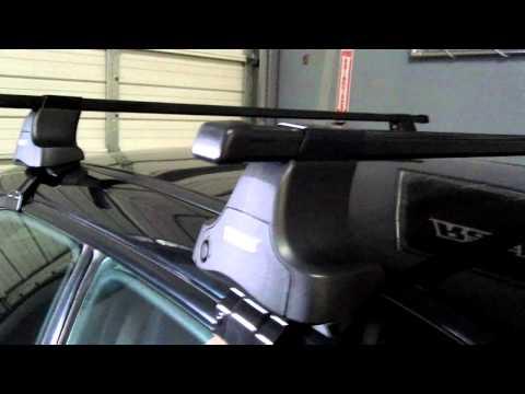 Subaru Impreza WRX STI Sedan with Thule Traverse Roof Rack by Rack Outfitters