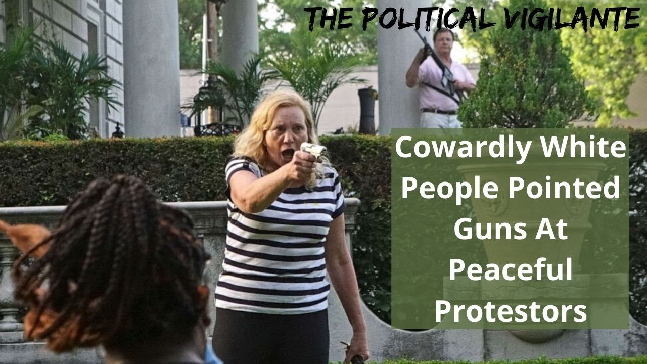 Crazy White Couple Point Guns At Protesters