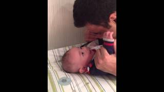Baby Playing With Daddy On The Changing Table