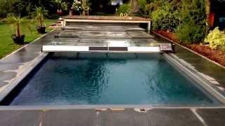 Repeat youtube video Schienenlose flache Poolüberdachung mit autarkem Elektroantrieb mit Photovoltaik