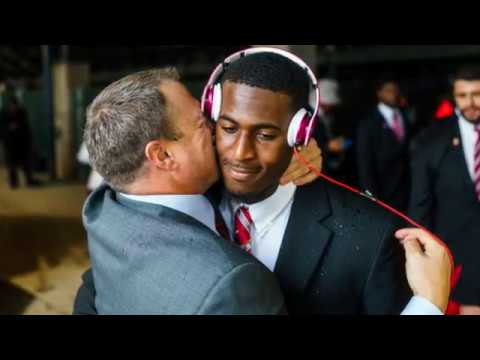 Texas Football Coach Tom Herman loves to kiss